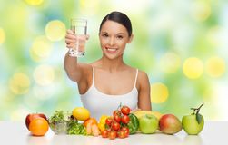 Happy woman with healthy food showing water glass Stock Photos