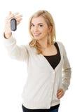 Happy woman holding a car key Stock Photos