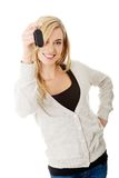 Happy woman holding a car key Stock Photography