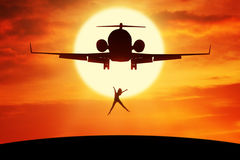 Happy woman leaps on the hill under airplane Stock Image