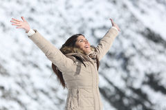 Happy woman raising arms on winter holidays Royalty Free Stock Photo