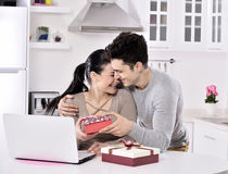 Happy young couple with gift boxes Stock Photo