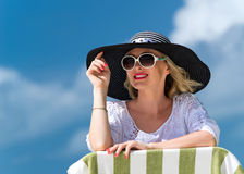 Happy young woman on the beach, beautiful female face outdoor portrait, pretty healthy girl relaxing outside, nature fun and joy, Royalty Free Stock Photography