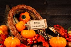 Harvest cornucopia with Happy Thanksgiving gift tag Royalty Free Stock Photo