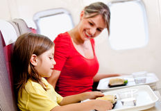 Having a meal in the airplane Stock Image