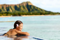 Hawaii beach travel woman relaxing at pool resort Stock Photography