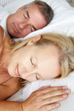 Head and shoulders mid age couple sleeping Stock Photography