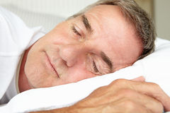 Head and shoulders mid age man sleeping Royalty Free Stock Photo