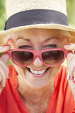 Head And Shoulders Portrait Of Smiling Senior Woman Wearing Sunglasses Stock Image