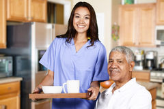 Health Care Worker and Elderly Man Stock Photos
