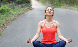 Healthy lifestyle fitness sporty woman have a meditation in the Royalty Free Stock Photography