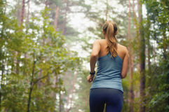 Healthy lifestyle fitness sporty woman running early in the morn Stock Photography
