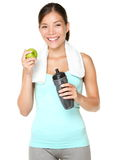 Healthy lifestyle - fitness woman eating apple Stock Photo