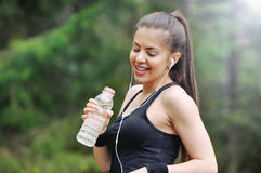 Healthy lifestyle sporty woman with headphone and bottle of wate Royalty Free Stock Image