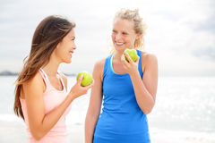 Healthy lifestyle women eating apple after running Royalty Free Stock Images