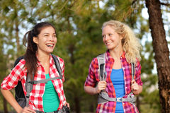 Healthy lifestyle women laughing hiking in forest Stock Photo