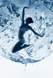 Healthy woman inside of blue water sphere Stock Photos