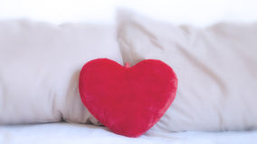 Heart pillow on the bed Royalty Free Stock Photos