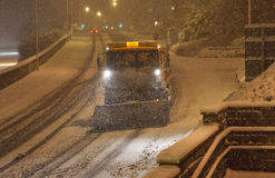 Heavy snow fall with snow plow / gritters Royalty Free Stock Image