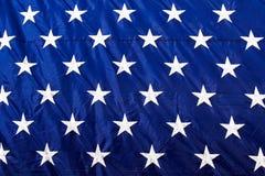 Het Amerikaanse Wit van de Vlagclose-up speelt Blauwe Achtergrond mee Royalty-vrije Stock Foto