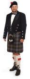 Highlander in kilt on white Royalty Free Stock Photo