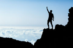 Hiking success silhouette, man trail runner in mountains Royalty Free Stock Photo