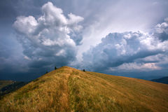 The hill in mountains on background of dramatic sky storm clouds Stock Image
