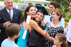 Hispanic Student And Family Celebrating Graduation Royalty Free Stock Image