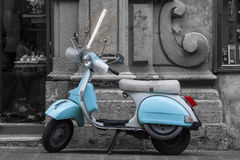 Historic Italian colored motorcycle scooter. Black and white Royalty Free Stock Photography