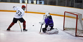 Hockey player trick shot Stock Photography