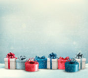 Holiday Christmas background with a border of gift boxes. Royalty Free Stock Photos