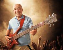 Hombre mayor de la guitarra Foto de archivo libre de regalías
