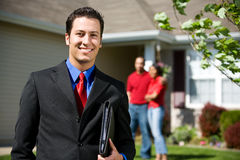 Home: Real Estate Agent Ready to Sell Home Royalty Free Stock Photography