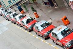 Hong- Kongverkehrsanblick, Taxiwartegeschäft Stockfotografie