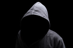 Hooded man in the shadow Royalty Free Stock Photo