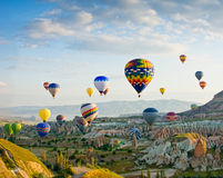 Hot air balloons flying over Red valley at Cappadocia, Turkey Stock Photos