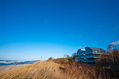 Hotel in sand dunes on beach in Baltics Royalty Free Stock Photography