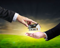 House in human hands Royalty Free Stock Photos