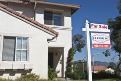 House With 'For Sale' Sign Stock Photos