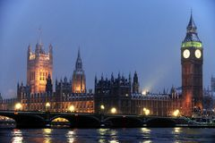 Houses of Parliament in the snow at nightfall Stock Photo