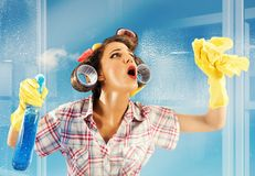 Housewife clean glass Royalty Free Stock Images