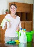 Housewife doing regular clean up in living room Stock Photography
