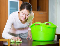 Housewife doing regular clean up in living room Royalty Free Stock Photos