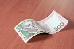 Hryvna ucraniano do dinheiro no fundo de madeira Imagens de Stock Royalty Free