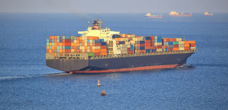 Huge container cargo ship outgoing from port Royalty Free Stock Photos