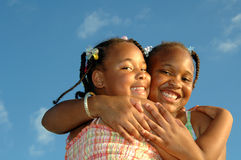 Hugging sisters Royalty Free Stock Images