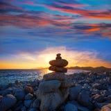Ibiza Cap des Falco beach sunset with desire stones Stock Photos