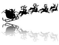 Impulsiones de Santa Claus en un trineo Fotos de archivo libres de regalías