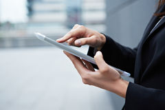 Index finger on tablet pc Royalty Free Stock Images