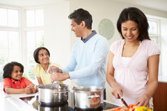 Indian Family Cooking Meal At Home Royalty Free Stock Images